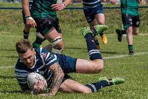 Kev Eadie dives over for a try on his return for Featherstone Lions against Saddleworth Rangers. Picture: Jonathan Buck