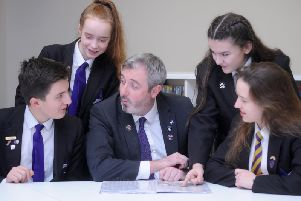 Pictured are pupils Joseph McGuinness, 13, Rebecca Fuller, 12, Lucy-Mae Cheatle, 13 and Kaja Baran, 15 with new headteacher John Woods.