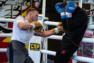 Josh Holmes (left) in sparring at the Phoenix Camp