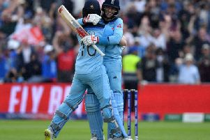 England's captain Eoin Morgan (l) and England's Joe Root celebrate victory during the 2019 Cricket World Cup second semi-final between England and Australia
