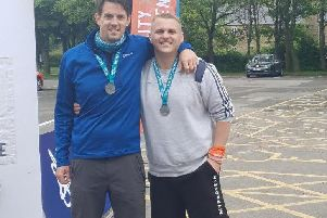 Robert McLeod (left) and GavinGoulds after completing the overnight fundraising hike in the Peak District
