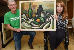 Christine Pilkington pictured with husband David, left, and the Wilfred Andrews painting which is to be sold for Macmillan