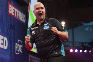 Rob Cross booked his place in the final four     Picture: Lawrence Lustig/PDC