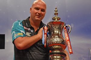 Rob Cross celebrates winning the Phil Taylor Trophy at the Winter Gardens      Picture: Chris Dean/PDC