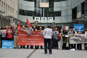 Senior citizens protest outside the BBC studios in London on June 21, 2019 against the end of government funding for free TV licenses for the over 75s. - Funding the free licences is due to be transferred from the Government to the BBC in 2019 as part of an agreement hammered out in 2015. The BBC has said that funding the universal scheme would mean the closure of BBC Two, BBC Four, the BBC News Channel, the BBC Scotland channel, Radio 5 Live, and a number of local radio stations. (Photo by Ben STANSALL / AFP)        (Photo credit should read BEN STANSALL/AFP/Getty Images)