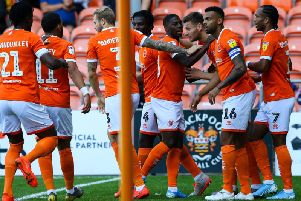 Blackpool celebrate Ryan Edwards' opening goal against Oxford