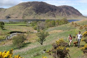 Walkers visiting in the Lake District in Cumbria.