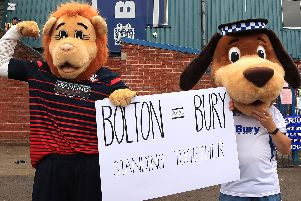Bolton mascot Lofty the Lion (left) and Bury mascot Robbie the Bobby at Gigg Lane