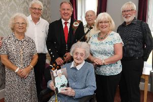 Family friend Catherine Hanson, son Andrew Warner, piper Charlie Sanders, second cousin Alistair Gardner, daughter in-law Jan Warner and family friend Ken Hanson with Flora at her birthday celebrations
