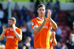 Ben Heneghan applauds the Blackpool fans after his cameo comeback at Rochdale