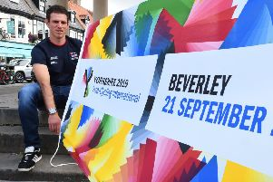 Double world and Paralympic champion Adam Duggleby with the Yorkshire 2019 Para-Cycling International Flag.