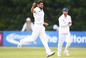 Anuj Dal celebrates taking a wicket for Derbyshire.