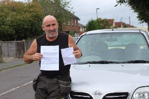 Barry King with his fine and MOT in front of his Micra