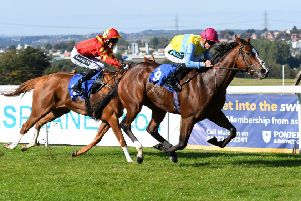 Lady Of Aran, ridden by Stevie Donohoe, gets ahead to win the Elkington Stud Supports Racing To School Ebf Premier Fillies' Handicap at Pontefract. Picture: Alan Wright