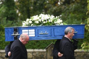 Pall bearers carry David's Tardis style coffin to the funeral