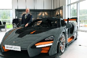 Mark Ballance, general manager of McLaren Leeds, with a Lego version of a McLaren