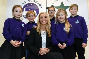 Quay Academy headteacher Kimberley Lawton celebrates with some of her pupils.
