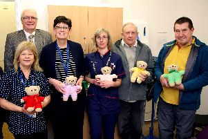 Anita Burnhill (service manager) Ceri Glove (nurse practitioner) and receptionist Debbie Duffill with Masons from the St John of Bridlington Lodge.