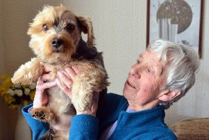 Marion Barras with dog Ollie after he was attacked by another dog