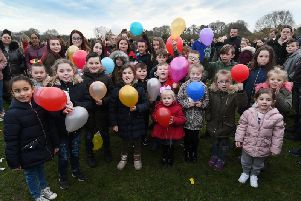 Youngsters prepare to release the colourful balloons at Gypsey Road.