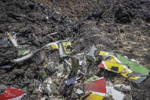 Wreckage lies at the scene of an Ethiopian Airlines flight that crashed shortly after takeoff at Hejere near Bishoftu, or Debre Zeit, on March 10. Picture: AP Photo.