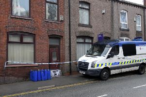 Police at the property on Manchester Road in Leigh