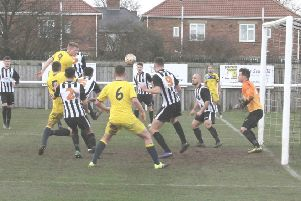 Stephen Ramsey heads home the only goal of the game in Whitley Bay's win over Ashington. Picture by Julian Tyley