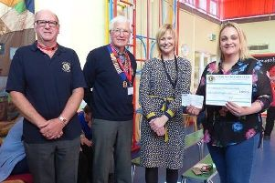 Richard Traves and fellow Lion Melvin White with Burton Agnes School headteacher Helen Jameson and fundraising co-ordinator Leanne Brewis.