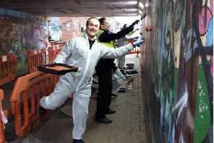 Cadets have repainted a graffitied  wall as part of their volunteering