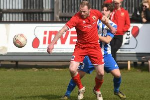 Brid Town player-manager Brett Agnew in action