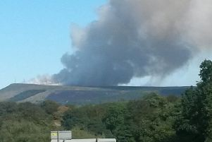 The huge plume of smoke rises over Rivington Moor during the height of the fire in June last year