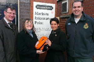 Handing over the defibrillator, back in 2013,  was Pat Gardner (second left) with Doncaster Markets facilities manager John Clarke, business relations manager Amy Lindsay and Yorkshire Ambulance Service's community defibrillator trainer Warren Bostock.