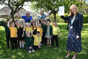 Headteacher Mari-Louise Booth celebrates the Ofsted comments with pupils and staff.