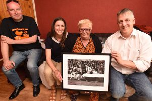 Gayle Hall is presented with a picture of her father, Tower clown Jimmy Buchanan.  She is pictured with (from left) publisher  Steve Richley, Jill Carruthers from Blackpool Museum Project and author Nigel Male.