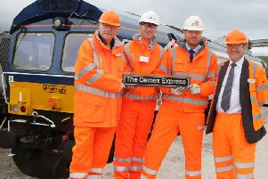 Pictured from left: Pete Waterman, David Hart (CEMEX), Lex Russell (CEMEX) and John Smith (GBRf).