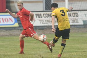 Benn Lewis in action for Brid Town against Tadcaster