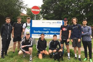 Lealholm Tigers Football Club members and Buddy the cocker spaniel outside Scarborough Hospital.