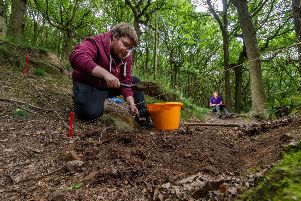 Volunteers help to unearth wartime secrets during a two-week community excavation in Long Wood, near Copley, Halifax.
