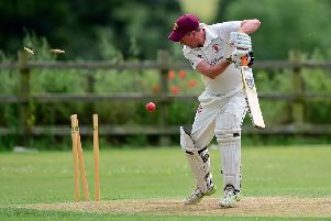 Glasshoughton's Ady Thackray is bowled by Hundhill Hall's Scott Latimer. Picture: Paul Butterfield