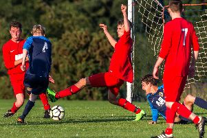 Whitby Fishermens Reserves Josh Linsley fires in an equaliser for his side during their 2-1 pre-season defeat against Kirkbymoorside Reserves on Monday night. PICTURES BY BRIAN MURFIELD