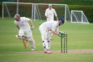 Tom Pateman manages to avoid being run out in Bromptons win against Heslerton in the Premier Division. PICTURES BY ANDY STANDING