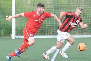 Josh Greening in action for Brid Town