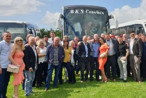 Toni-Anne Mortimer (pictured in the orange dress in the centre) with her husband Lee (to the right of Toni-Anne) and customers from the Hare and Hounds in Padiham enjoy a day at Ripon Races.