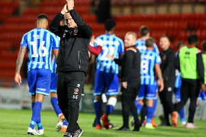 Simon Grayson applauds the Pool fans at full time