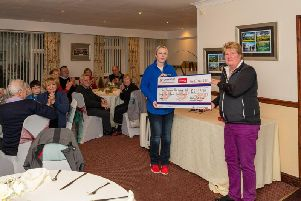 Bridget (right) handing over a cheque to Louise