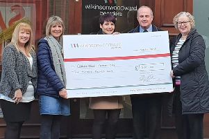 Cafe cash: Kath Mashinter (second left) receives the cheque from Wilkinson Woodward Bearders.