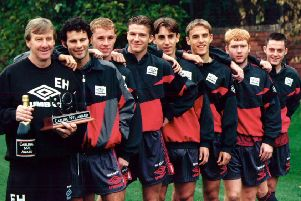 Eric Harrison with his Class of 92 stars