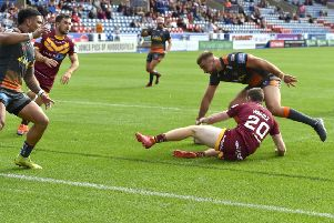 Mike McMeeken touches the ball down for a try for Castleford Tigers against Huddersfield Giants. Picture: Matthew Merrick