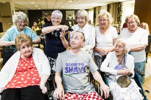 Close shave: Michael Young (centre front) with Willow Court residents.