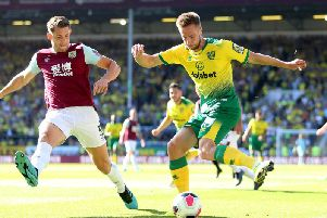 Marco Stiepermann of Norwich City is challenged by James Tarkowski of Burnley